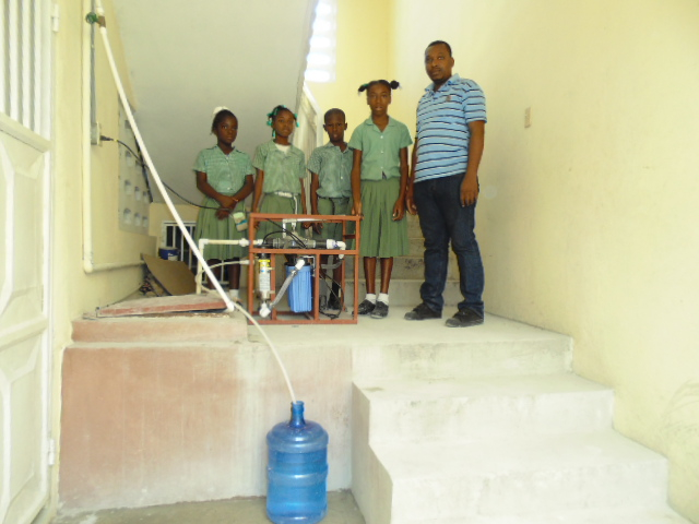 Teacher and school kids at MUSPAN school with LGF UN Manual hand pump system